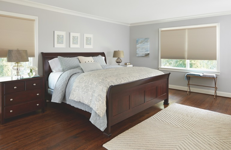 Beige shades in a Raleigh bedroom.