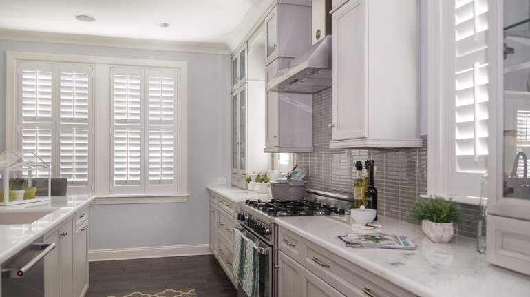 Plantation shutters in Raleigh kitchen with modern appliances.