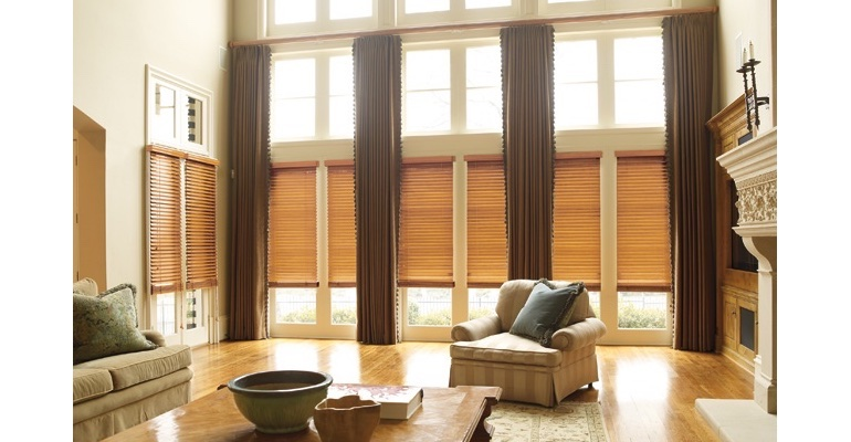 Raleigh great room with wood blinds and full-length draperies.