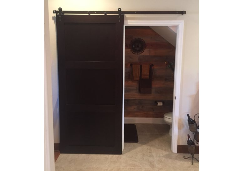 Brown bathroom sliding barn door