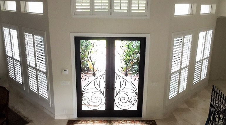 Raleigh foyer with glass doors and interior shutters