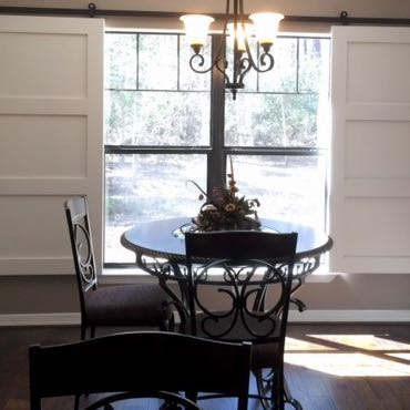 Raleigh dining room barn door shutters.