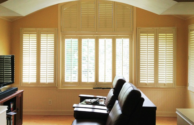 Raleigh plantation shutters in entertainment room