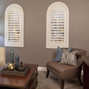 Raleigh family room arched shutters.