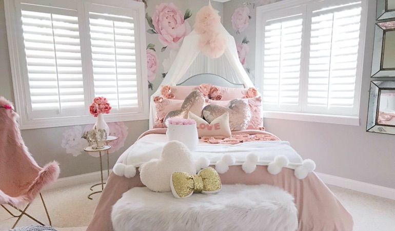 Plantation shutters in a girls bedroom