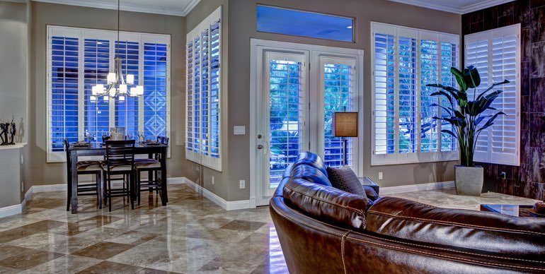 Raleigh great room with classic shutters and tile floor.