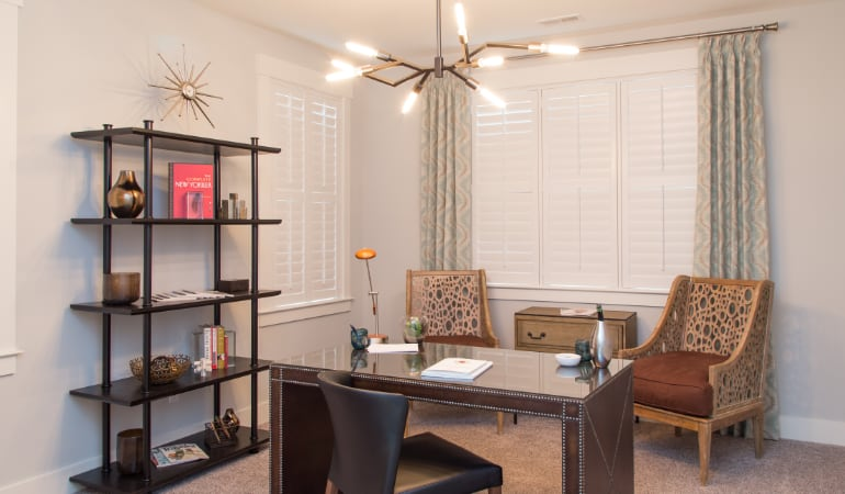 Raleigh home office with plantation shutters.