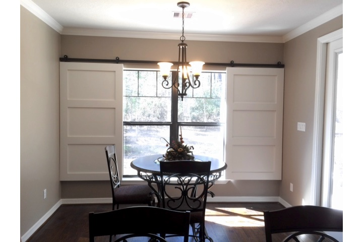Raleigh dining room with moveable barn door shutters.