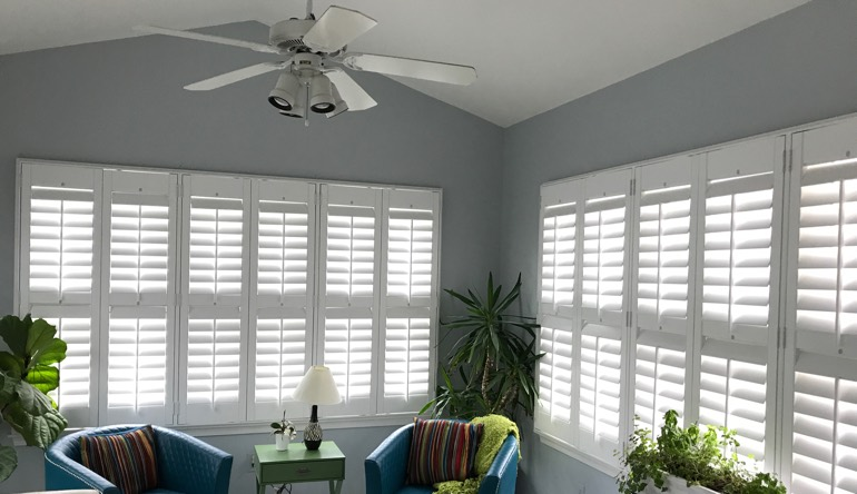 Raleigh sunroom with fan and shutters