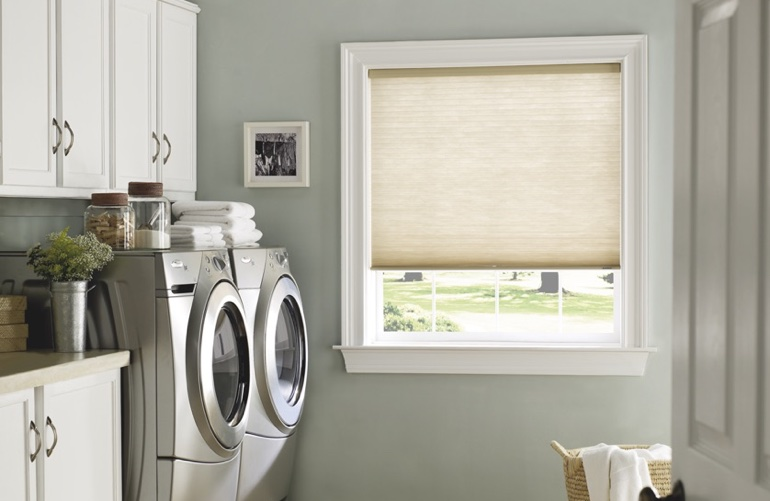 Raleigh laundry room with tan window shades.