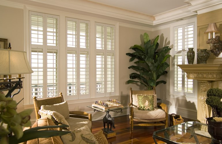 Living Room in Raleigh with polywood plantation shutters.