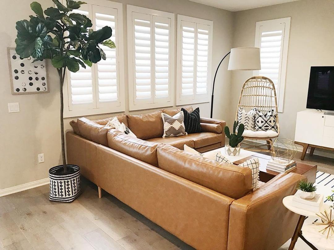 Warm living room with our Polywood shutters in Raleigh.
