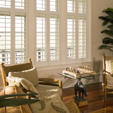 Raleigh living room plantation shutters.
