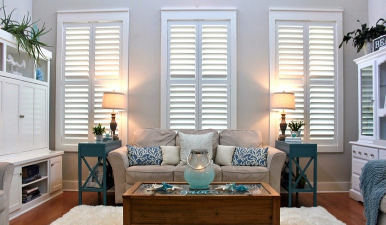 Raleigh designer sunroom with plantation shutters
