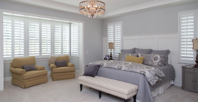 Interior shutters in Raleigh bedroom.
