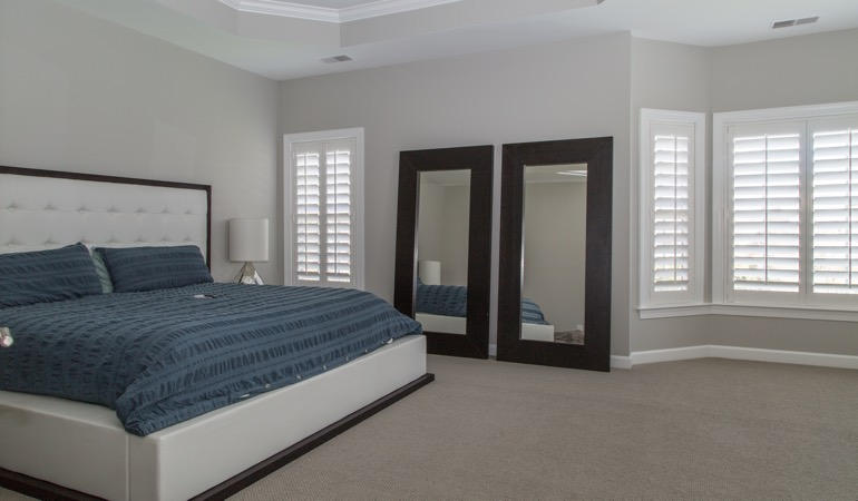 White shutters in a minimalist bedroom in Raleigh.