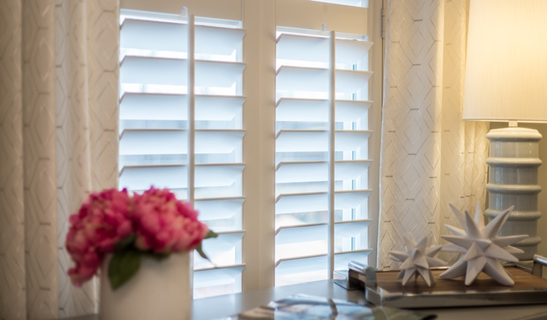Plantation shutters by flowers in Raleigh
