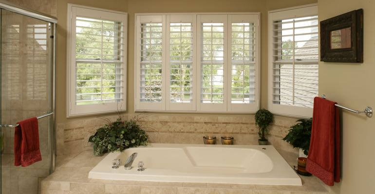Plantation shutters in Raleigh bathroom.