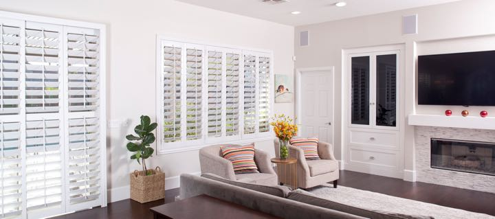 Raleigh living room in white with plantation shutters.