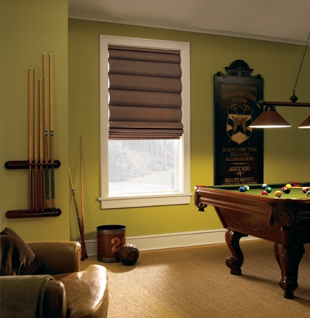 Roman shades in Raleigh rec room with green walls.