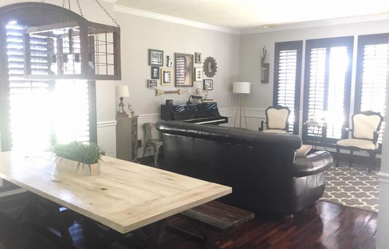 Natural Wood shutters in living room windows by Sunburst Shutters Raleigh.
