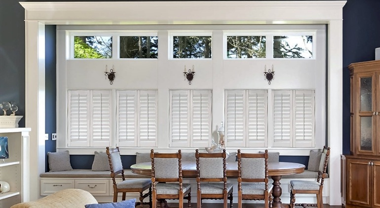 Raleigh dining room with white plantation shutters.