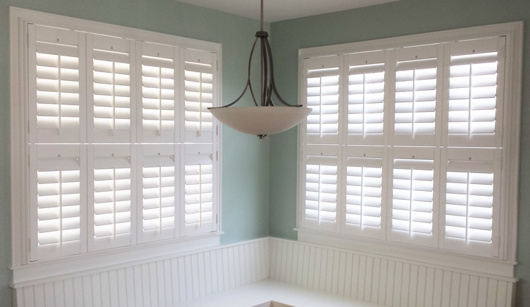Soft green wall in Raleigh kitchen with shutters.