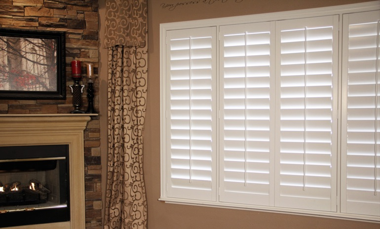 Raleigh Studio plantation shutters in living room.