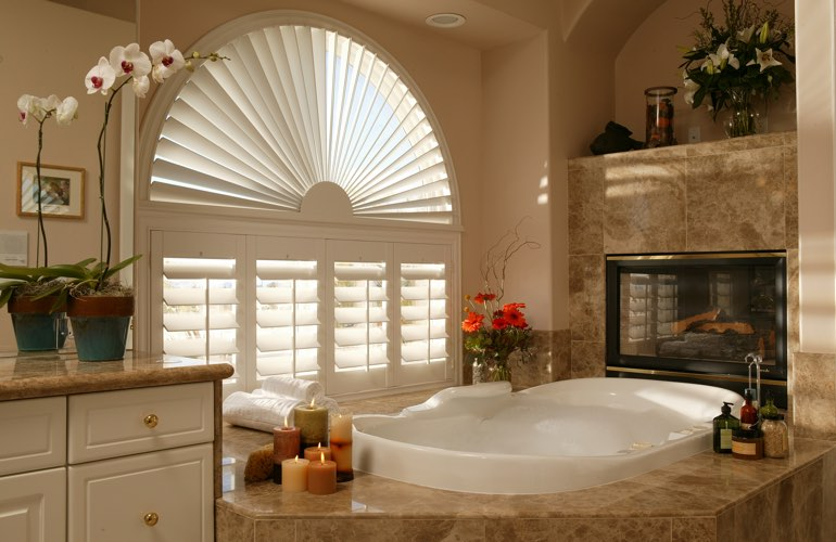 Semicircle shutters in a Raleigh bathroom.