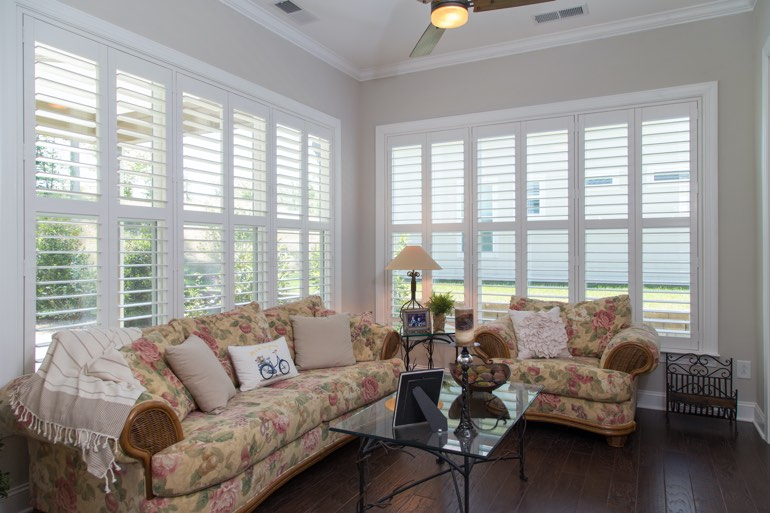 Airy sunroom with plantation shutters in Raleigh.