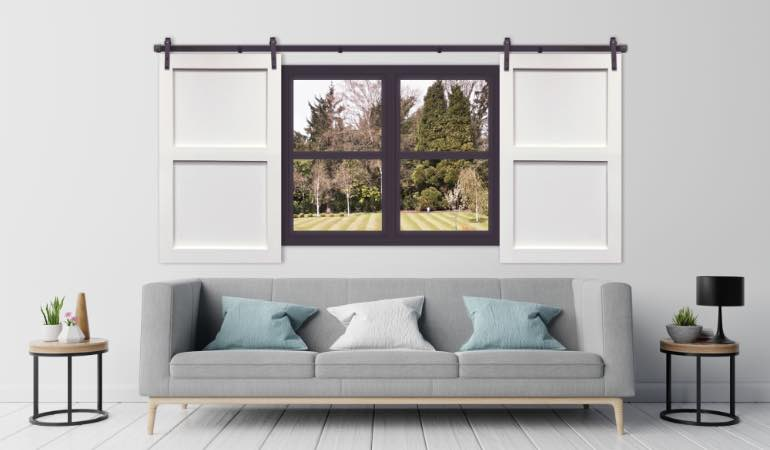 White barn door shutter in streamlined Raleigh living room