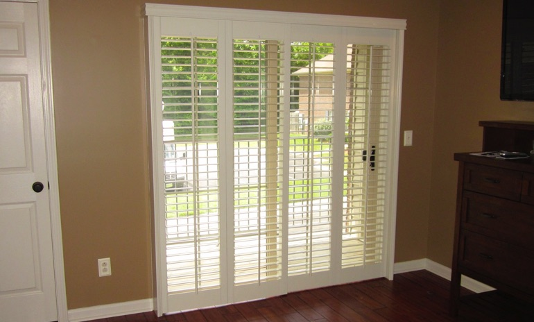Raleigh sliding door bifold shutters in den