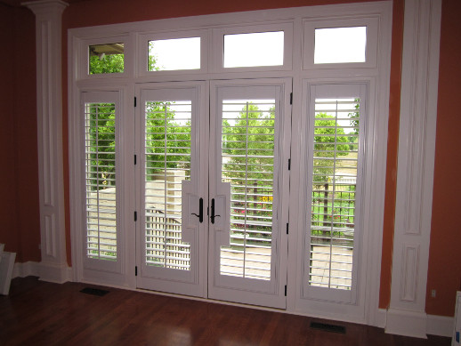 Raleigh patio door with sidelight shutters