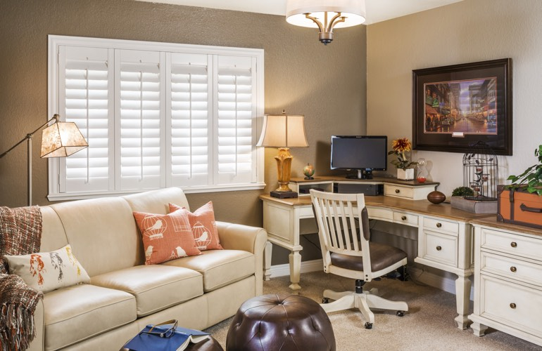 Raleigh home office with white window shutters.