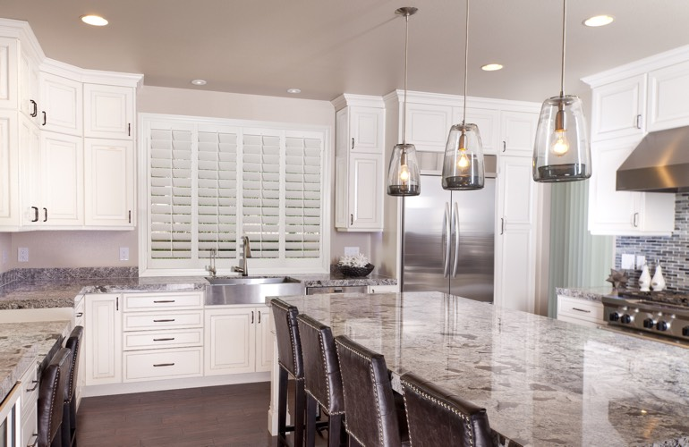 A modern kitchen with plantation shutters