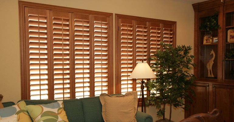 Natural wood shutters in Raleigh living room.